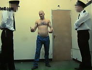 The guards are having fun today. A shaven headed thug has been cheeky and almost looking to get in on the strip search action. If that's what he wants then who are the guards to refuse! He can't help ...